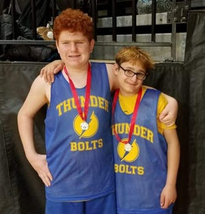 Vincent Nasi (left) and his twin brother Dominick Nasi pose with Special Olympics medals. The brothers are looking forward to competing in the Special Olympics New York Summer Games.