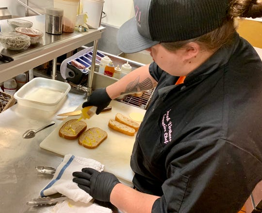 Jacob Vorhees, executive chef of Bistro 71, prepares a sandwich in the kitchen the morning of Wednesday, April 17. Vorhees came to the Chambersburg restaurant about a month ago to take over for his uncle, Scott Vorhees, who previously held the position.