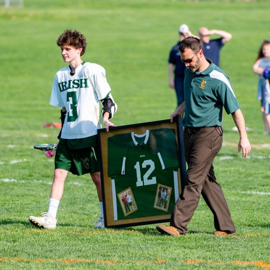 During halftime of the York Catholic and York Suburban lacrosse game, the Fighting Irish honor former player Brendan O'Connor, April 18, 2019. He died suddenly in September while playing lacrosse.