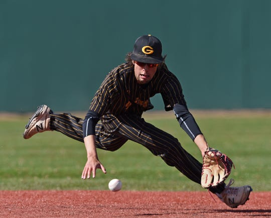 Galena's Reece Scolari goes after a Manogue hit during Tuesday's game at Bishop Manogue.
