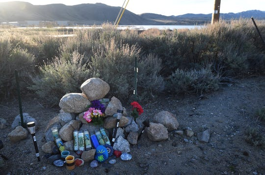 A memorial is seen near Silver Lake, north of Reno, for Sunni DiCarrillo on April 17, 2019. DiCarrillo's body was recently found after a lengthy search. The 17-year-old's kayak was found floating in the lake shortly after he was reported missing last March.