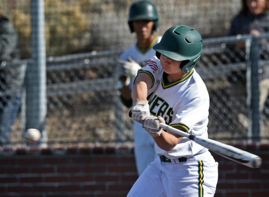 Bishop Manogue's Rylan Charles takes a swing at the ball for a home run against Galena during Tuesday's game.