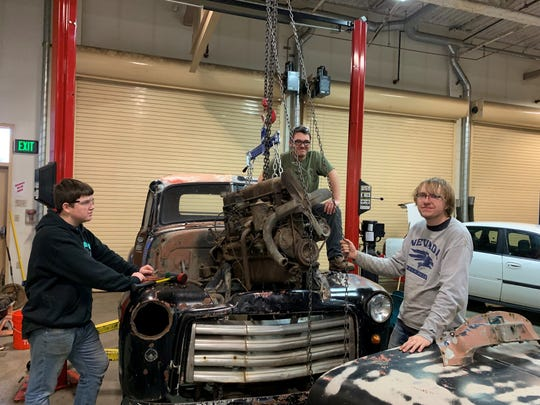 Sunni Dicarrillo, 17, (center) and two classmates pose for a photo during their diesel technology class at North Valleys High School.