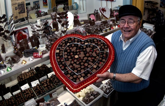 Peter Livadas of Peter's Sweet Shop with a 5-pound box of candy for a Valentines sale.