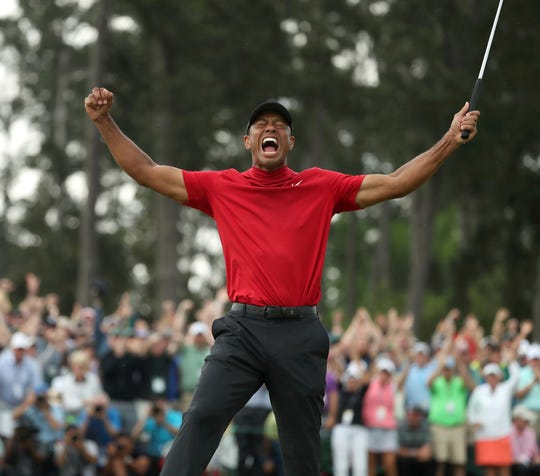 Jason Getz's shot of Tiger Woods celebrating his Masters win has been used by newspapers nationwide.