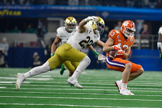 Notre Dame linebacker Drue Tranquill (23) defends against Clemson wide receiver Hunter Renfrow (13) .