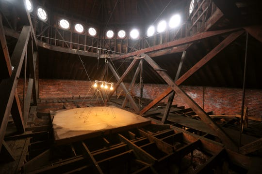 The attic area of First Universality Church in downtown Rochester has large wooden support beams and is not easy to access.