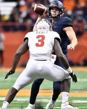 North Carolina State linebacker Germaine Pratt lines up Syracuse quarterback Eric Dungey last season.