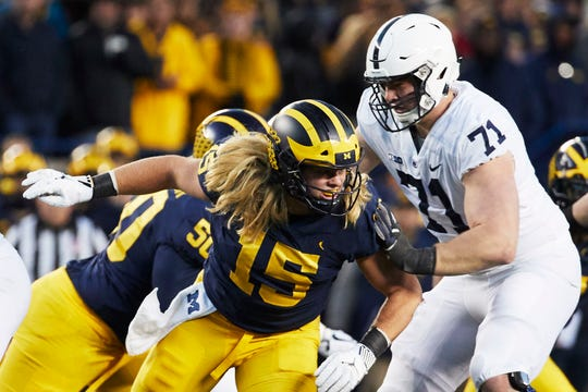 Michigan edge rusher Chase Winovich (15) works against Penn State offensive lineman Will Fries (71).