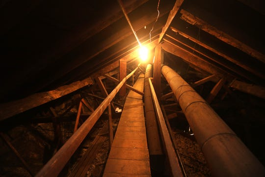 The attic area of Church of St. Luke & Simon Cyrene on Fitzhugh Street in downtown Rochester has a walkway through large wooden support beams.