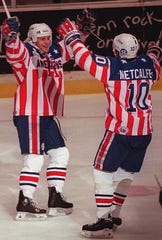 The Rochester American's Brian Holzinger, left, and Scott Metcalfe celebrate Rochester's fourth goal against the Syracuse Crunch on Saturday, May 25, 1996. Rochester won the game and the Western Conference series that night.