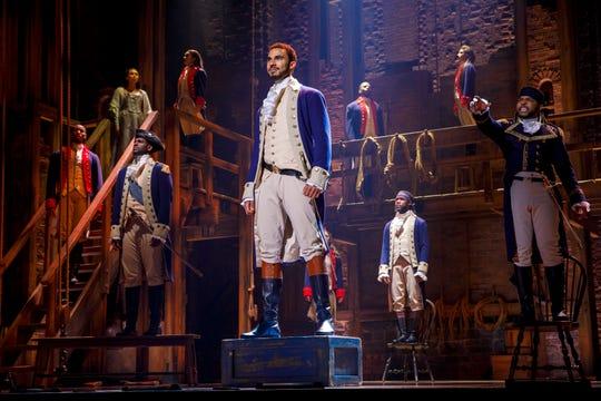 The company of the Hamilton national tour.