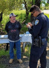 Fletcher is interviewed by a Redding police officer in this contributed picture.
