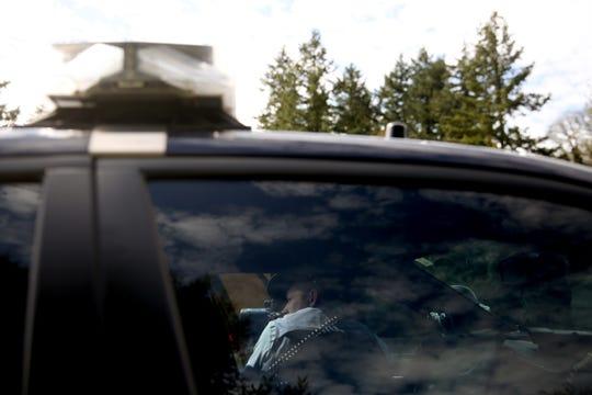 Oregon State Police Senior Trooper Jeff Freitag checks traffic speeds on I-5 south of Salem on April 18, 2019.