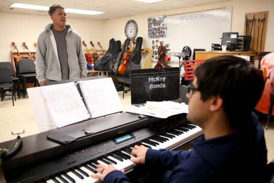 LJ Allise, a McKay senior, sings a piece as choir director Peter Sepulveda accompanies on piano at McKay High School in Salem on April 17, 2019. Allise takes private singing lessons thanks to the Music Lessons Project which offers private or small group lessons to students in Title I schools.