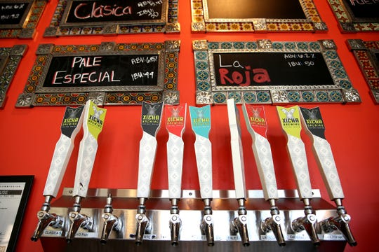 Xicha Brewing taps are pictured at the bar in Salem on April 17, 2019. The Brewery has been open for a year and a half.