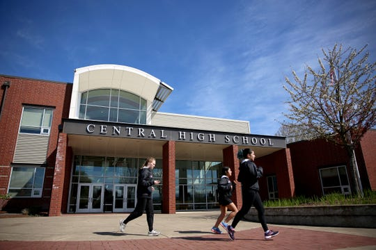 Students jog in front of Central High School in Independence on April 17, 2019.