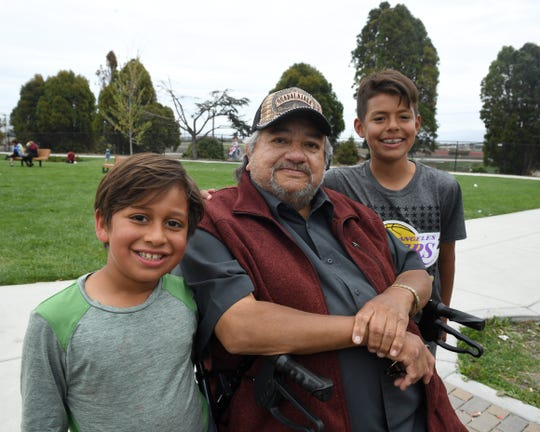"""Salinas resident Rogelio Jacinto has been diagnosed with Valley Fever. He already lost his brother-in-law to Valley Fever and the news of his diagnosis has weighed on him. Here, he poses for a photo with two of his grandchildren, Jacob Christian Jacinto, 9, and Rogelio """"Kike"""" Jacinto III, 12."""