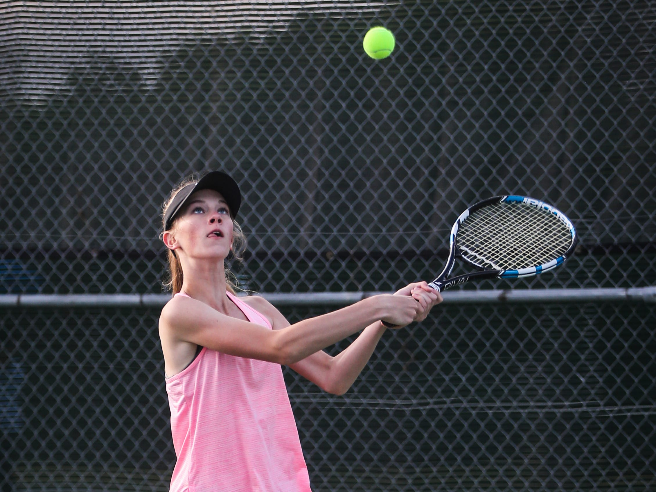 Crowell's Seanna Trainham goes for the ball during the doubles game at the region II -1A tennis championship Thursday, April 18, 2019, at Bentwood Country Club.