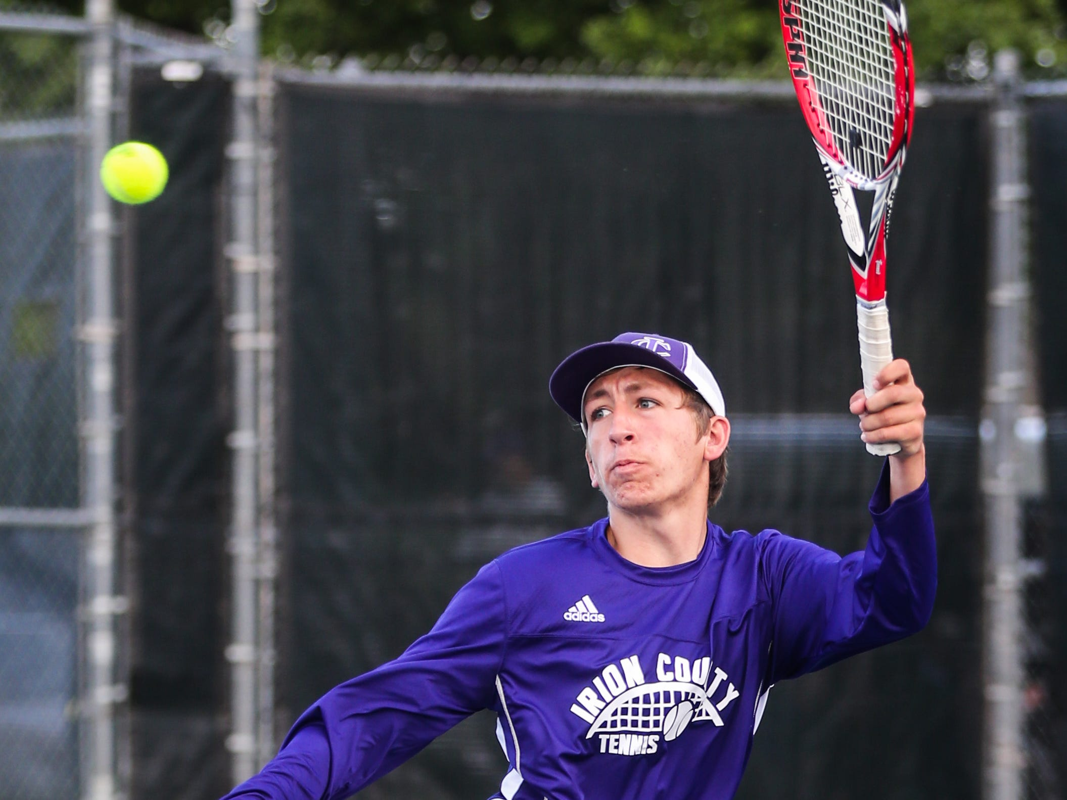 Irion County's Kaden Councilman hits the ball during the region II -1A tennis championship Thursday, April 18, 2019, at Bentwood Country Club.