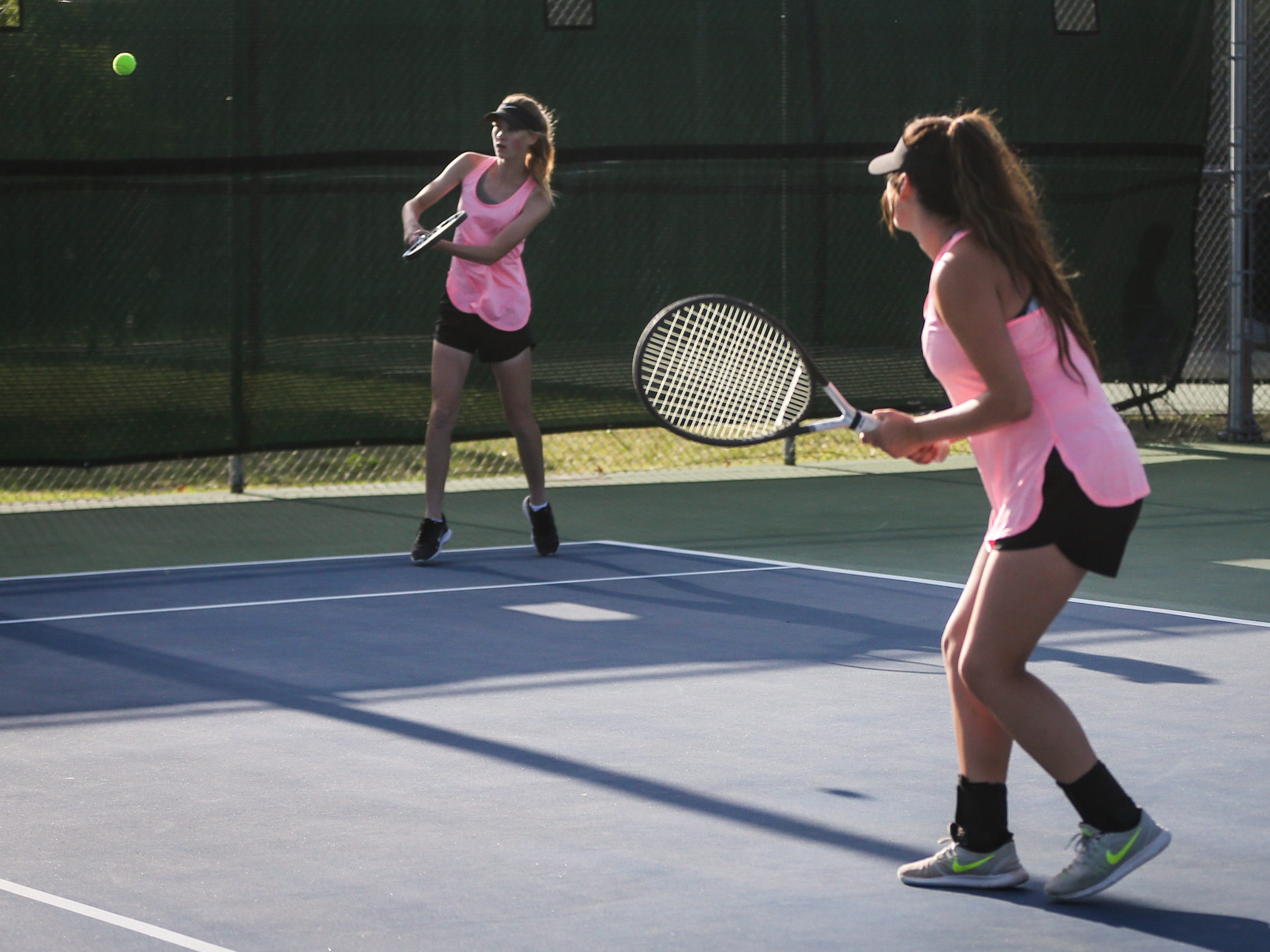Crowell's Seanna Trainham goes for the ball during the doubles game with partner Paige Moya at the region II -1A tennis championship Thursday, April 18, 2019, at Bentwood Country Club.