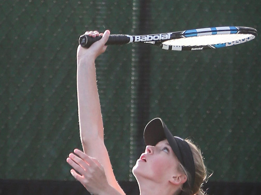 Crowell's Seanna Trainham serves the ball during the doubles game at the region II -1A tennis championship Thursday, April 18, 2019, at Bentwood Country Club.