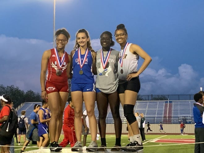 San Angelo Lake View's Jordan Pickney (gray shirt) poses with the top four finishers in the girls 200 meters at the Districts 5&6-4A Area Track and Field Meet Wednesday, April 17, 2019, in Graham.