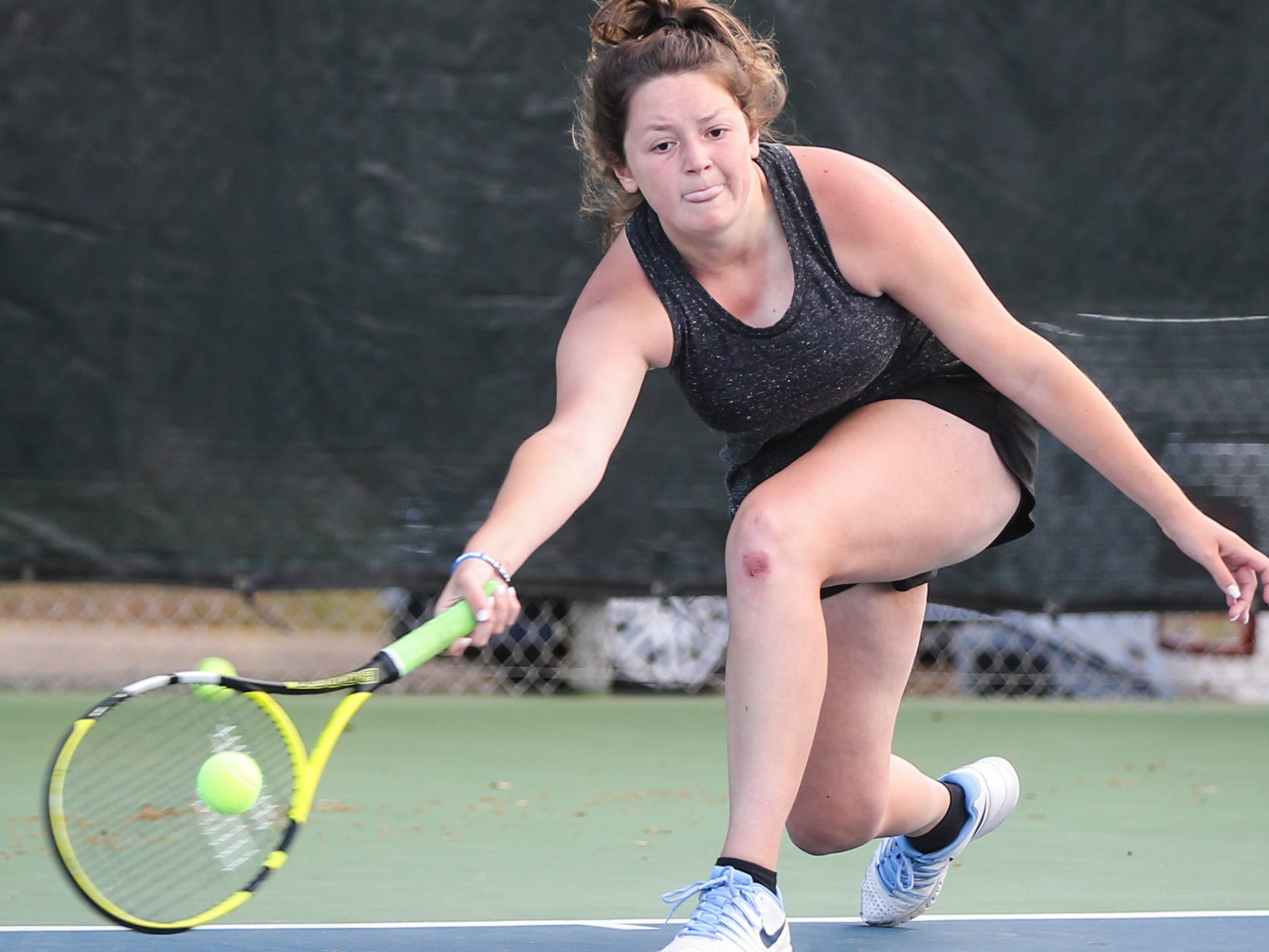 Paint Rock's Lauren Tonne goes for the ball during the region II -1A tennis championship Thursday, April 18, 2019, at Bentwood Country Club.