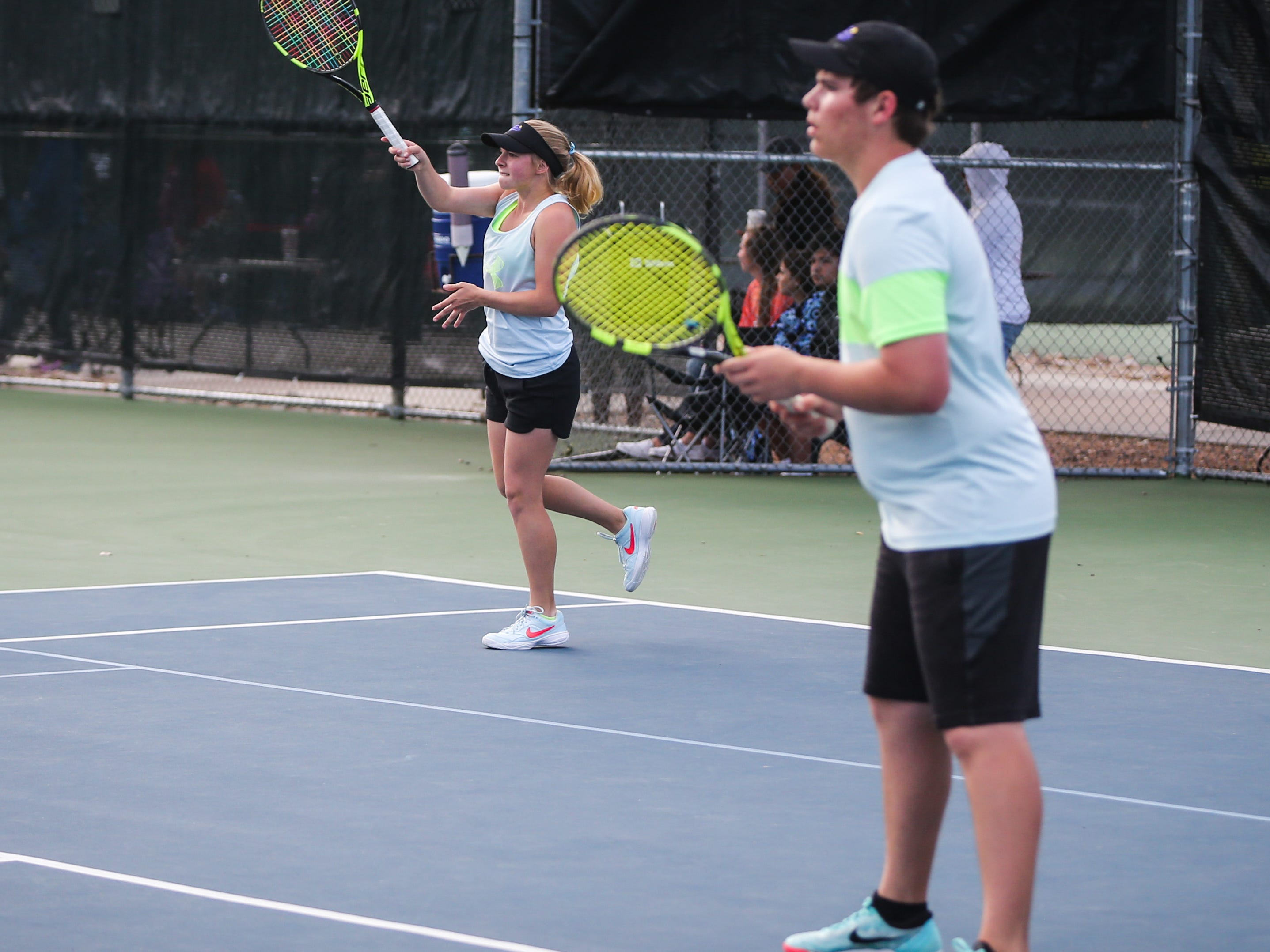 Sterling City's Brooke Rauch and Dain Copeland play during the mixed doubles region II -1A tennis championship Thursday, April 18, 2019, at Bentwood Country Club.