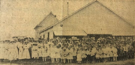 Members of Immanuel Baptist Church in San Angelo pose in front of a temporary tabernacle located at the church's first property, on the southwest corner of 19th Street and Volney in 1911.