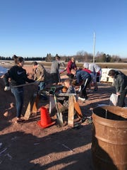 Volunteers help to fill sandbags during the spring flooding in Dell Rapids.