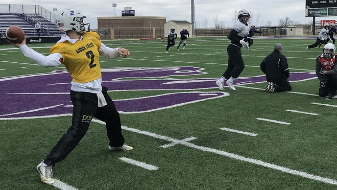 USF quarterback Caden Walters delivers a pass Wednesday afternoon at practice at Bob Young Field