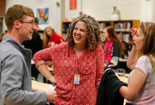 Courtney Dameron, center, a teacher at Hillcrest High School, laughs with students in mid-April. She was named Springfield Public Schools' Teacher of the Year for the 2019-20 school year.