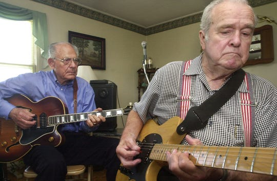 -  -Speedy Haworth, right and Virgil Glenn, pick their guitars during a reunion. Haworth died in 2008. Photo for the News Leader by Michael Petrosky