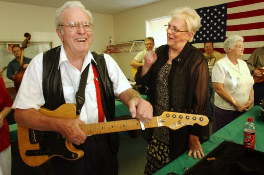 - -Speedy Haworth, left, jokes with his daughter Shirley Jean Haworth before the two perform Friday night at the Rogersville Community Center. He died in 2008. Photo/Christina Dicken/News-Leader