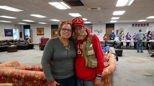 In this file photo taken at the Veterans Coming Home Center, Devery Mills, founder of Hearts for the Homeless, poses with Kenneth 'Wulf' Bailey, who was homeless at the time. Mills recently ended her nonprofit, Hearts for the Homeless.