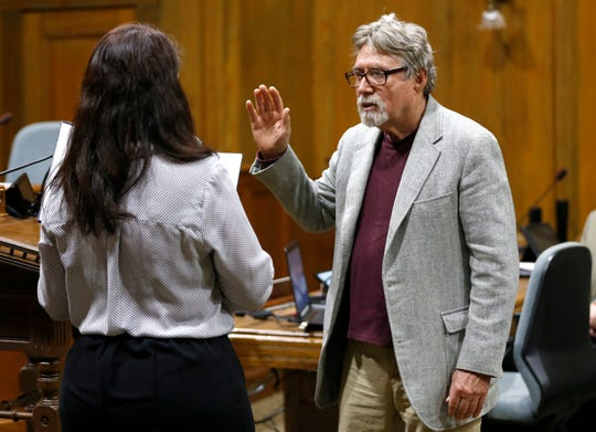 Incumbent councilmen Mike Schilling takes his oath of office in the council chambers on Thursday, April 18, 2019.