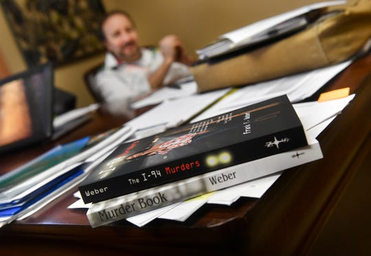 Forensic psychologist and author Frank Weber talks about his books during an interview Tuesday, April 16, 2019, in Sartell.