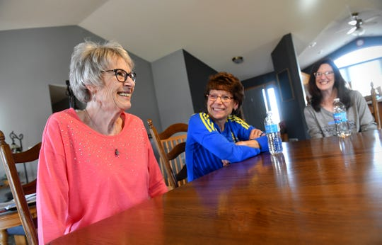Geri Novotny, left, talks about her plans to run the Earth Day 5K with her daughters Wanda Gau, center, and Denise Rinne, right, Tuesday, April 16, in Sauk Rapids.