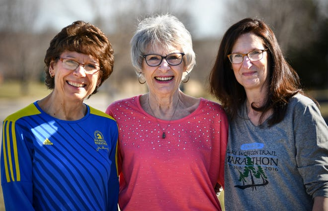 Geri Novotny, center, poses for a photograph with her daughters Wanda Gau, left, and Denise Rinne, right, Tuesday, April 16, in Sauk Rapids. After years of cheering for her daughters in races throughout the country, Novotny, 73, plans to run the Earth Day 5K on Friday.
