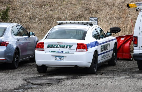 A security car is parked in a lot behind the CentraCare Health Plaza Thursday, April 18, in St. Cloud.