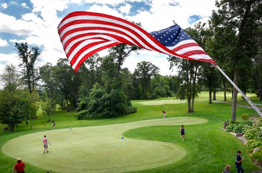 The American flag waves gracefully over the practice green at Blackberry Ridge Golf Course & Event Center in Sartell.