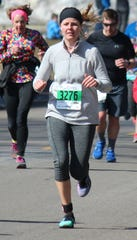 Casey Myers runs in the CentraCare Health Earth Day half-marathon relay in St. Cloud in April 2018. Myers died in a car crash in December. This year, her co-workers from CentraCare Rehabilitation are running Earth Day races in Myers' memory.