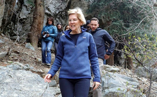 Democratic presidential candidate Sen. Elizabeth Warren, D-Mass., walks with Carl Fisher, of Save Our Canyons, during an visit to Big Cottonwood Canyon Wednesday, April 17, 2019, east of Salt Lake City. Warren is in Utah Wednesday after promising to restore broader public lands protections for two of the state's high-profile national monuments if elected president. It's a move that would not endear her to Utah's GOP establishment but could appeal to voters across the West angered by President Donald Trump's decision to shrink the monuments. (AP Photo/Rick Bowmer)