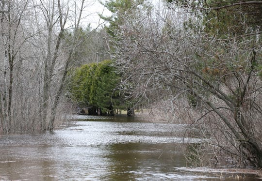 Flood waters flow on Thursday, April 18, 2019, along Park Road near Galecke Park in the town of Plover, Wis. Residents in the area had been advised to evacuate. Tork Mason/USA TODAY NETWORK-Wisconsin