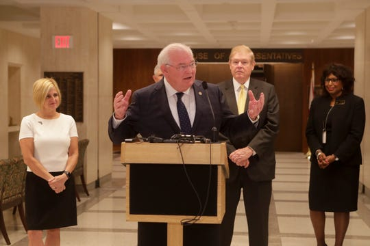 Sen. Bill Montford speaks during a news conference held to discuss state disaster relief funds with college sports coaches and lawmakers Thursday, April 18, 2019.