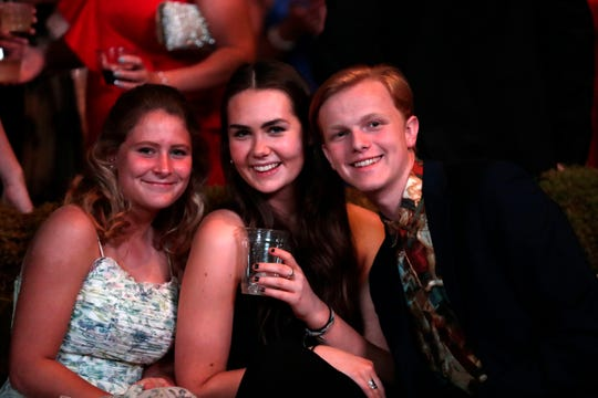 Mattie Ziegler, left, Maggie Watson, and Everett Reed pose for a photo during cocktail hour at TMH's 36th annual Golden Gala Thursday, April 18, 2019.