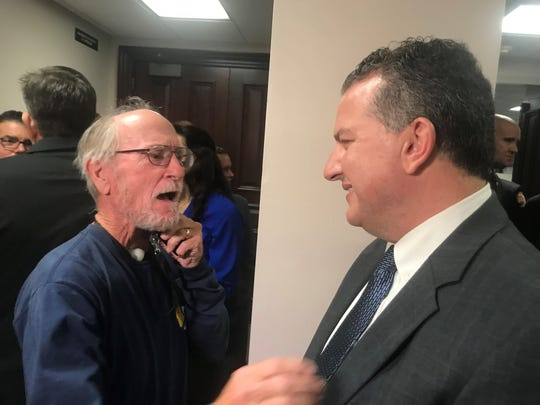 Retired Brevard County firefighter Jay Post and cancer survivor shares a congratulatory moment with State Fire Marshal Jimmy Patronis after passage of a bill that gives cancer coverage to firefighters.