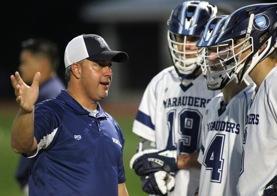 Maclay head coach Justin VanTassel talks to his lacrosse team during Wednesday's district semifinals. The Marauders beat Leon 19-0.