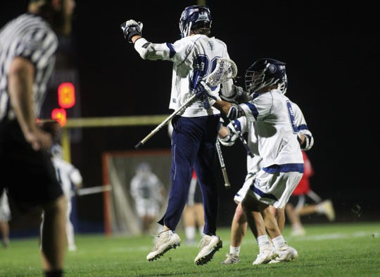 Maclay senior goalie Jackson Hugill scores his first career goal and celebrates with Matthew Winegardner (6) as Maclay beat Leon 19-0 during a district semifinal on Wednesday.
